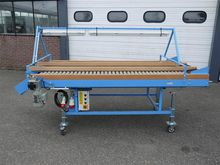 New roller inspection conveyor