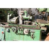 Grinding machine for unitary an