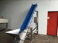 NNP Flighted elevator conveyor