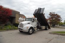 2011 KENWORTH T370 Hook roll of