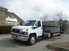 2009 GMC C5500 trailer and Car