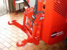 Lifting system for mini-shovel