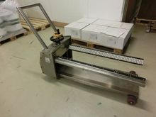 Feeder trolley for shrink foil