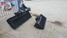 Used lawn rakes for