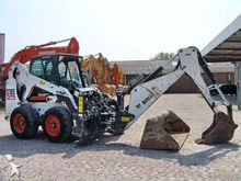 2006 Bobcat + excavator arm