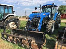 Used HOLLAND TM140 i
