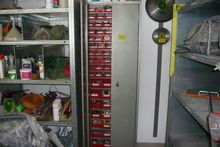 Sheet metal cabinet with conten