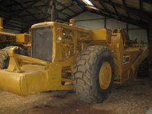 Used Cat 627 scraper