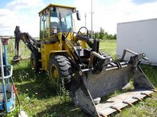 Used 2014 backhoe lo