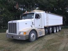 1996 Peterbilt 377 Quad Axle Tr
