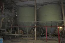 Storage tank feed silo