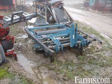 Used 3 pth mulch pla