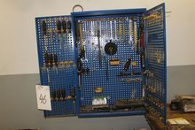 Tool cabinet containing various
