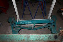 A gypsum board facing Mountit (
