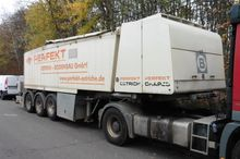 Screed transport mixing and con
