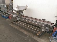 A&B Volumetric Clamshell Filler