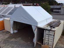 Ny Proof hall mellom containere