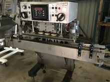 Capping machine capper