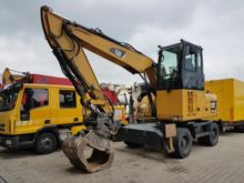 2010 Caterpillar M313D Wheeled