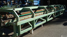 Special conveyor for sawmill an