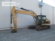 2010 CATERPILLAR 323DL