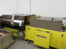 Foiling machine with shrink tun