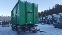 Tipper trailer into container