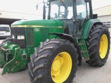 1999 John Deere 6910 Farm Tract