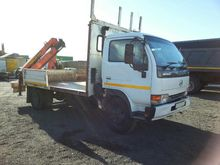 2011 NISSAN UD 40 DROPSIDE WITH