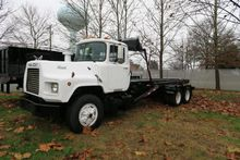 1994 MACK DM690 ROLL OFF TRUCK