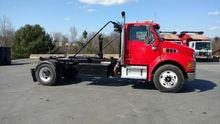 2006 STERLING ROLL OFF TRUCK