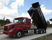 2012 VOLVO VNL64T300 DUMP TRUCK
