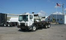 2002 MACK MR688S ROLL OFF TRUCK