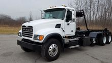 2005 MACK CV713 ROLL OFF TRUCK