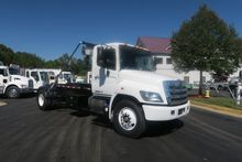 2017 HINO 338 ROLL OFF TRUCK