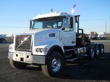 2012 VOLVO VHD104F CONVENTIONAL