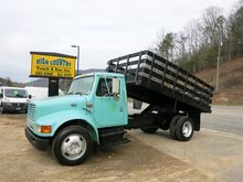 1999 INTERNATIONAL 4700 DUMP TR