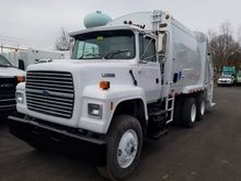 1996 FORD LN GARBAGE TRUCK