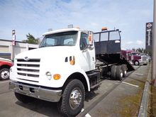 1999 STERLING L8501 ROLLBACK TO