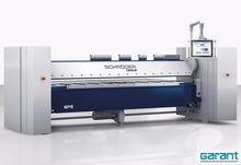 Folding machine with apron