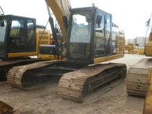 2012 Caterpillar Inc. 320EL