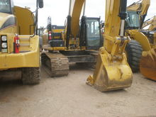 2013 Caterpillar Inc. 336EL HYB